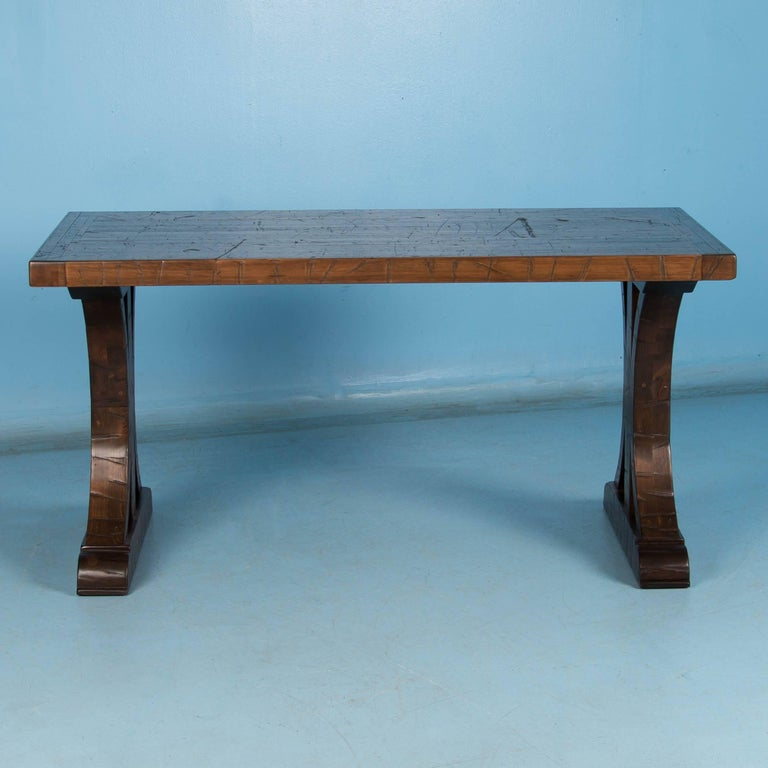 The strong visual impact of this table is due to the reclaimed oakwood top and architectural feel of the base. The heavy top is made from vintage reclaimed railroad boxcar flooring so it shows the wear and distress of constant years of use. The base