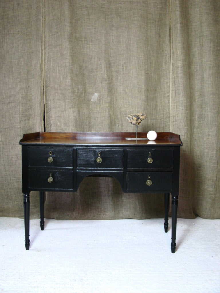 Lovely small black early Victorian bureau writing table with mahogany top.  The drawers have original brass lion handles  This is a very decorative piece what could make a lovely decorative and useful piece to your home  space seating 62 cm