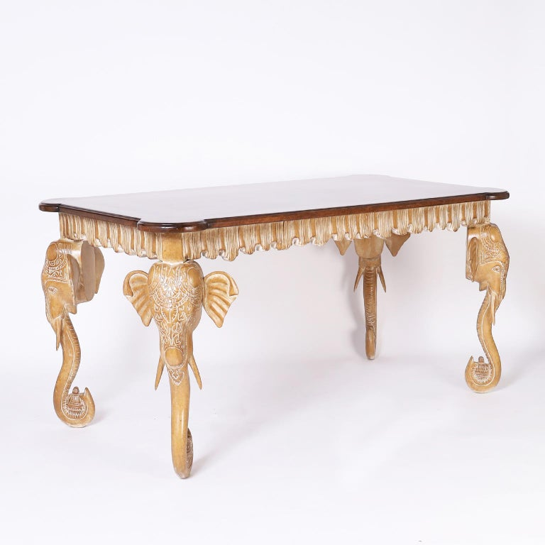 Mid century Italian one drawer writing table with a walnut top having a decorative beveled edge on a pickled or white washed bleached walnut base with a pleated apron and carved elephant head legs.