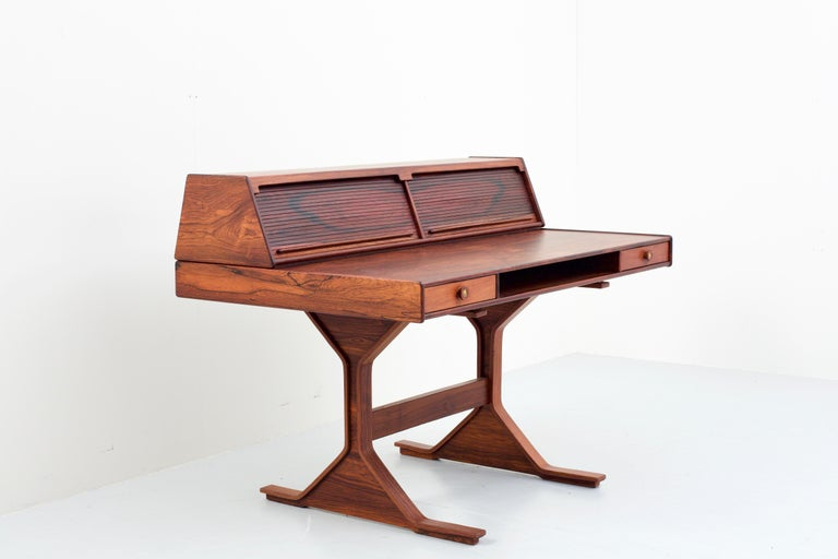 Rosewood Writingdesk with tambours shutters by Gianfranco Frattini for Bernini in marvellous condition. The desk comes from a house near Napoli and has never seen any sun nor was it used a lot, resulting in a splendid version. The wood is still very