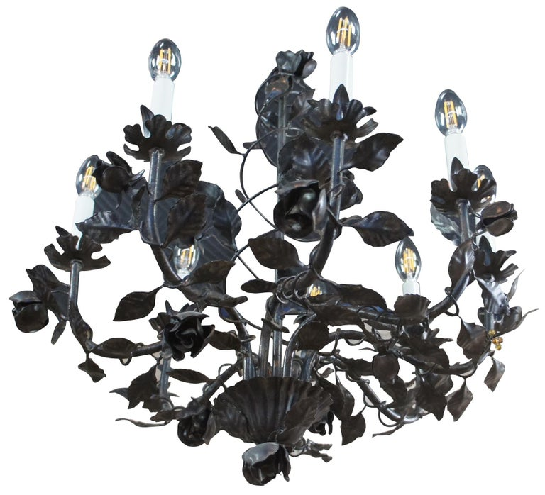 Vintage eight arm wrought iron chandelier featuring roses on a vine with spiral and scrolled design. Measure: 25