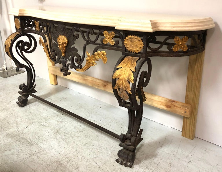 This is a substantial console table. The metal work is exquisite with lots of detail. Console attaches to the wall. Shown with temporary wood supports.