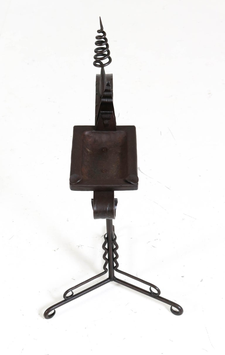 Wonderful and rare Art Deco Amsterdam School ashtray stand. Design by J. Boerman. Striking Dutch design from the twenties. Wrought iron with decorative lining. In very good original condition with a beautiful patina.