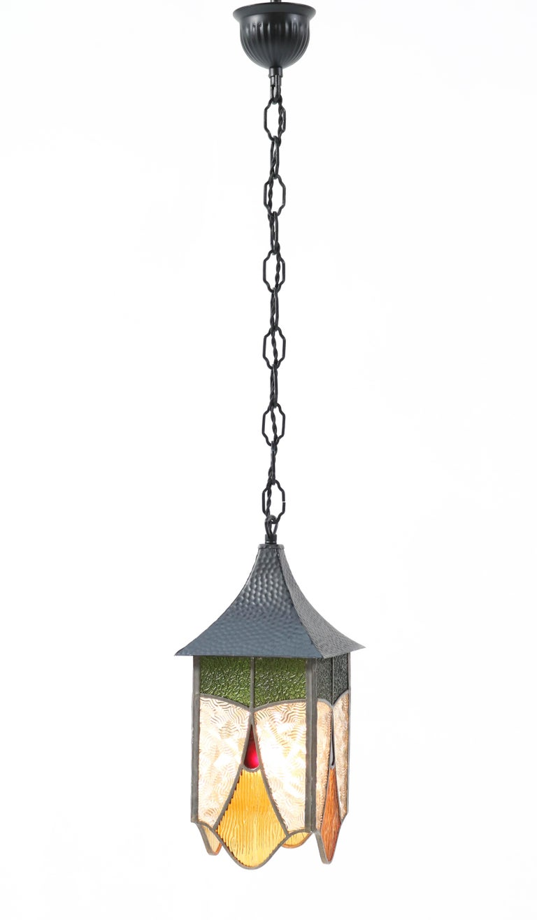 Stunning Art Deco lantern. Striking Dutch design from the 1930s. Wrought iron frame with original stained glass shade. Rewired with one socket for E-27 light bulb. In very good condition with a beautiful patina.