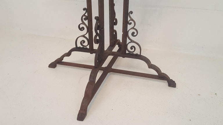 Wrought iron stand. Stripped of paint.  Could be used with marble top  (top in picture is an example and is not included) as a console in combination with wrought iron mirror.