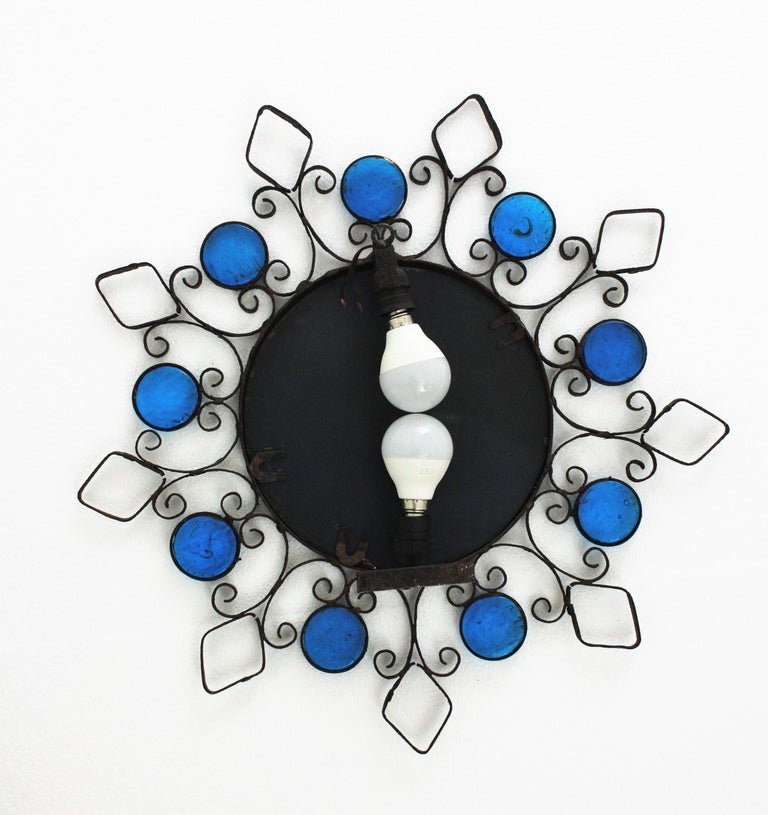 Wrought Iron Backlit Sunburst Mirror with Blue Glasses and Scroll Motif For Sale 5