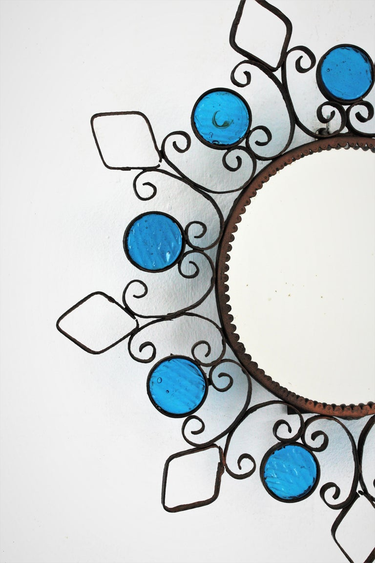 Wrought Iron Backlit Sunburst Mirror with Blue Glasses and Scroll Motif In Excellent Condition For Sale In Barcelona, ES