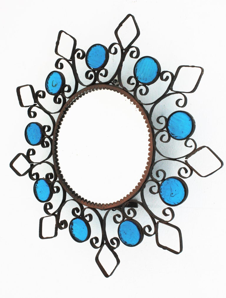 Wrought Iron Backlit Sunburst Mirror with Blue Glasses and Scroll Motif For Sale 1