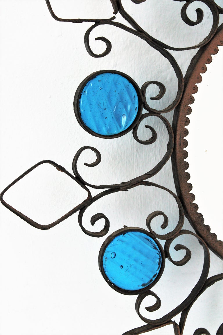 Wrought Iron Backlit Sunburst Mirror with Blue Glasses and Scroll Motif For Sale 2