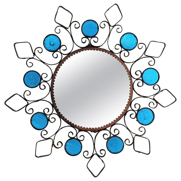 Wrought Iron Backlit Sunburst Mirror with Blue Glasses and Scroll Motif For Sale