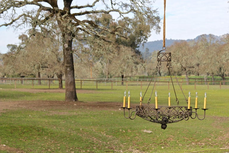 Highly detailed forged iron basket chandelier with detailed scrollwork. Made by our artisan iron worker. The size shown is large and is ready to ship. This item is also made to order, and available in size small - 29