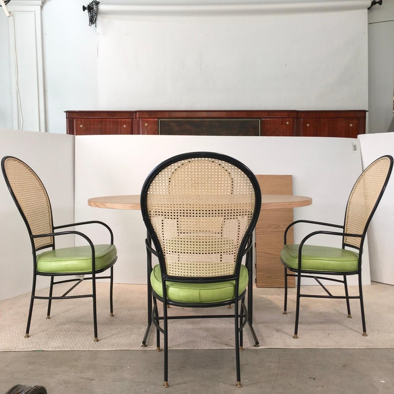 Hollywood Regency Wrought Iron Caned Back Chairs and Dinette Table For Sale