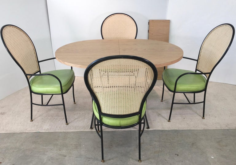 Blackened Wrought Iron Caned Back Chairs and Dinette Table For Sale