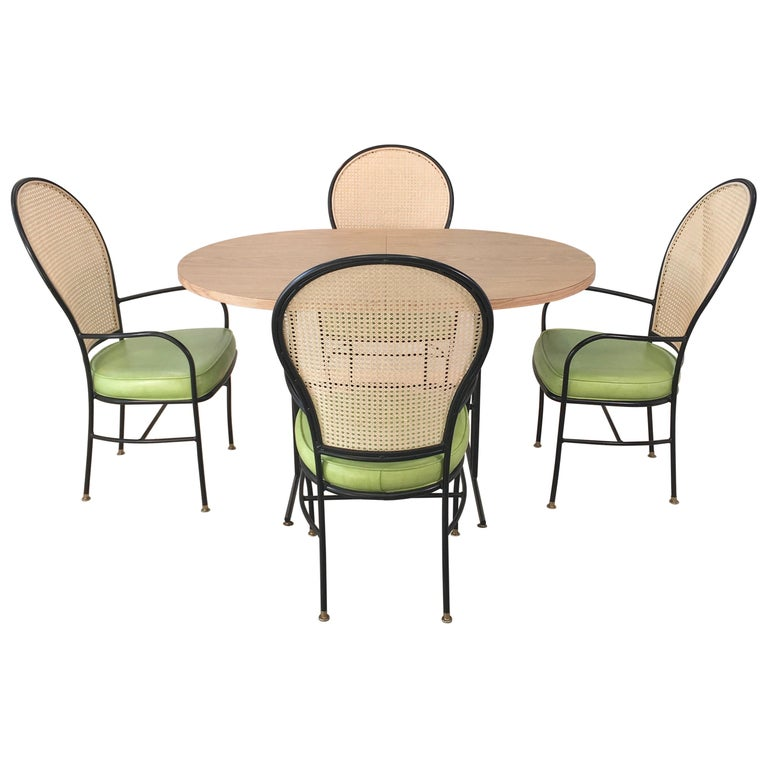 Wrought Iron Caned Back Chairs and Dinette Table For Sale