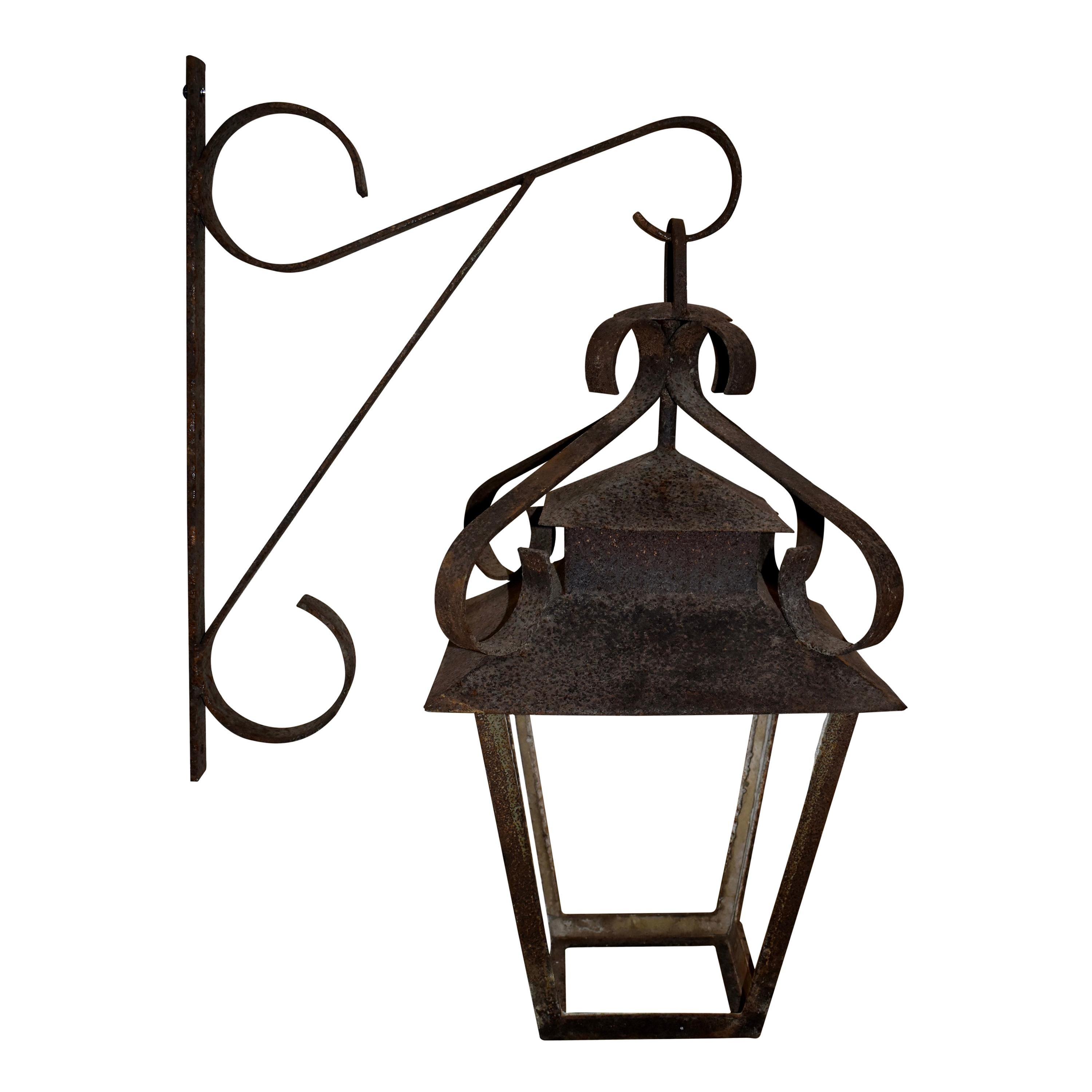 Wrought Iron Lantern Suspended from Wall Bracket, circa 1900