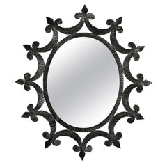 Wrought Iron Oval Sunburst Mirror with Scroll Details and Brutalist Design