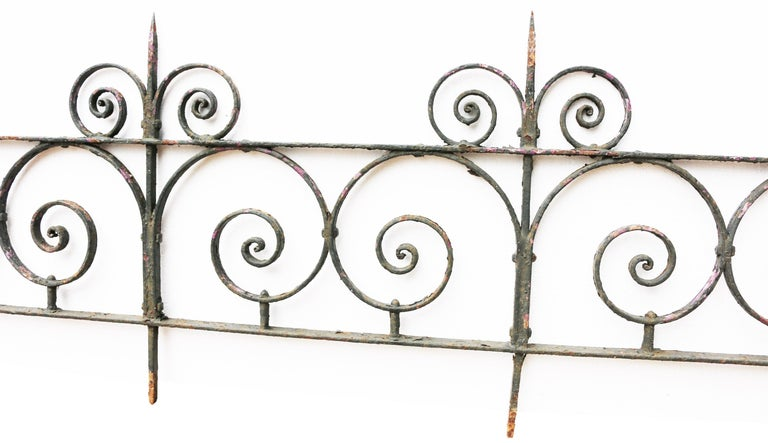 An antique wrought iron side gate, with post and a 2.75 meter length of low railing. Good structural condition. Old flaky paint. Gate: Height 112 cm Width 85 cm Depth 3 cm Post: Height 112 cm Width 36 cm Depth 3 cm Railing: Height 52 cm Width