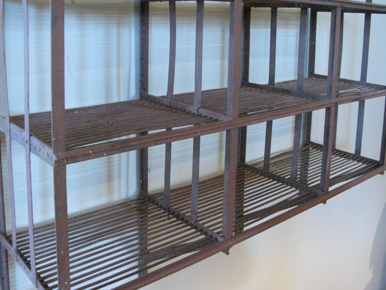 Wrought Iron Wall-Hanging Shelving Rack In Good Condition For Sale In Hudson, NY