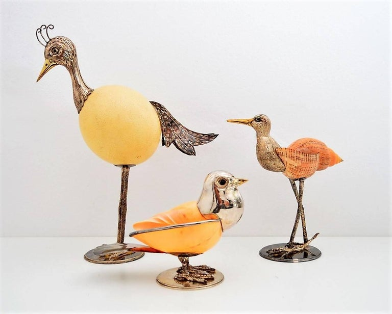 Beautiful set of three bird sculptures, one-of-a-kind artwork of excellent craftsmanship entirely handcrafted, with ostrich egg and seashells as body, and silver plated hand formed details. Made in Italy, 1970s, remind as to works from Antonio