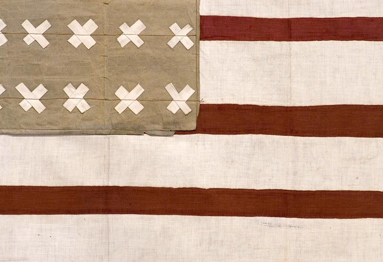 WWI, BELGIAN-MADE VERSION OF THE STARS & STRIPES WITH 30 CROSS-HATCH STARS, USED TO WELCOME U.S. SOLDIERS INTO THE CITY OF VIRTON, BELGIUM IN 1918, FOLLOWING ITS LIBERATION FROM GERMAN OCCUPATION  This 30 star flag was homemade by a Belgian citizen