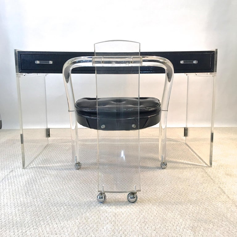 The superior quality is evident the moment you lay eyes upon this pristine 1970's vintage black lizard and lucite writing desk from Wycombe Meyer. The thick heavy lucite slab sides have beveled edges as well as black acrylic corner guards. Black