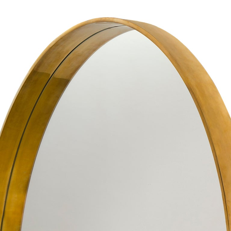 A Wyeth Original round wall mirror handcrafted from heavy gauge bronze in a polished finish. Produced by the Wyeth Workshop in Brooklyn, NY. Meas  Available in custom sizes, metals and finishes. Lead times and prices vary.