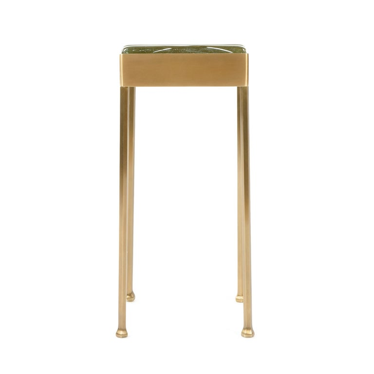 A WYETH Original, framed glass block cocktail / side table on faceted legs with forged feet in patinated bronze.