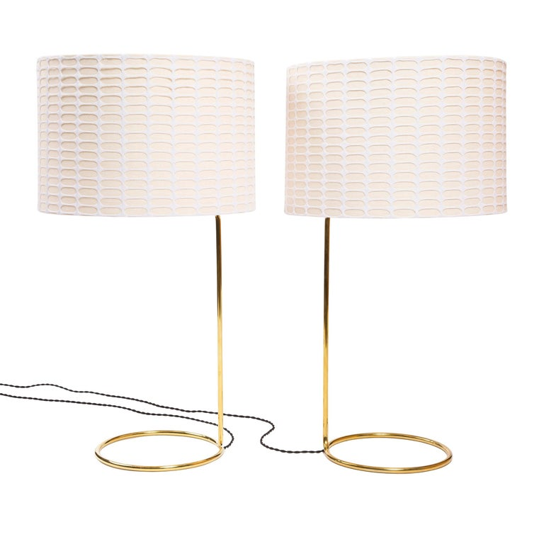 A spare, sinuous table lamp made from a continuous coil of thinly gauged bronze tubing. Produced by the Wyeth Studio in NYC.
