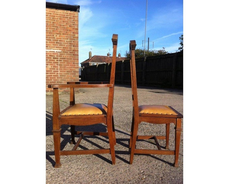 Arts and Crafts Wylie & Lochhead, Set of Four Arts & Crafts Oak Dining Chairs with Leather Seats For Sale