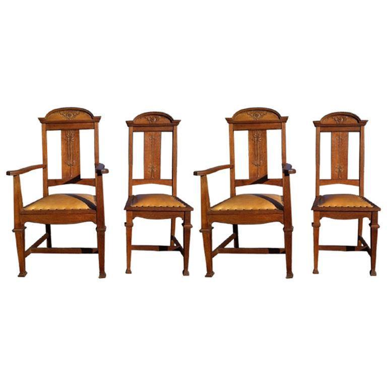 Wylie & Lochhead, Set of Four Arts & Crafts Oak Dining Chairs with Leather Seats For Sale
