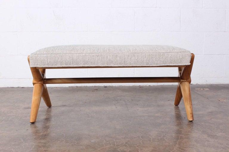 A maple X base bench designed by T.H. Robsjohn-Gibbings for Widdicomb.