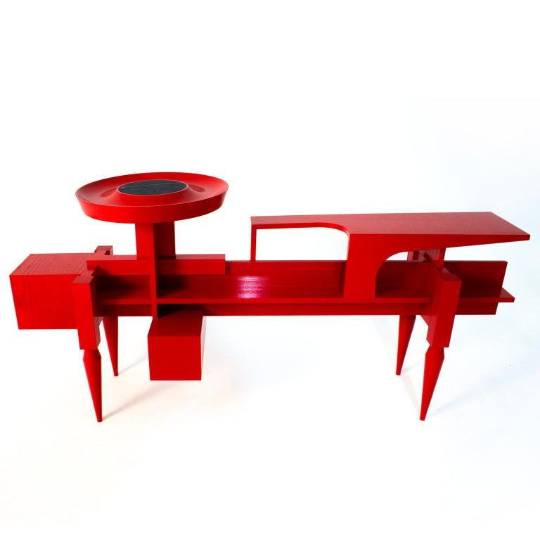 The newest product X introduces new colors and materials. It can be seen as a console with a special complexity of design, many graphical elements such as surfaces out of lacquered ash-tree and a marble component on the top. Nevertheless, this