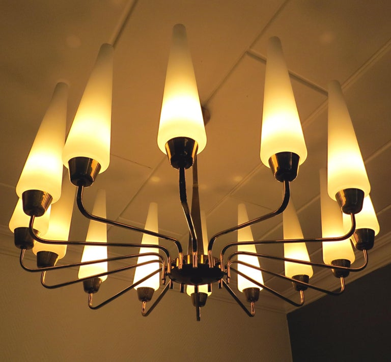 We offer here an exclusive, timeless modern and oversize Sputnik or Tulip chandelier with almost 31.5 inches diameter, from France, 1950s. The vintage ceiling light has 14 glass - funnels. Design is in style of Arlus, Stilnovo & Hans-Agne Jakobsson