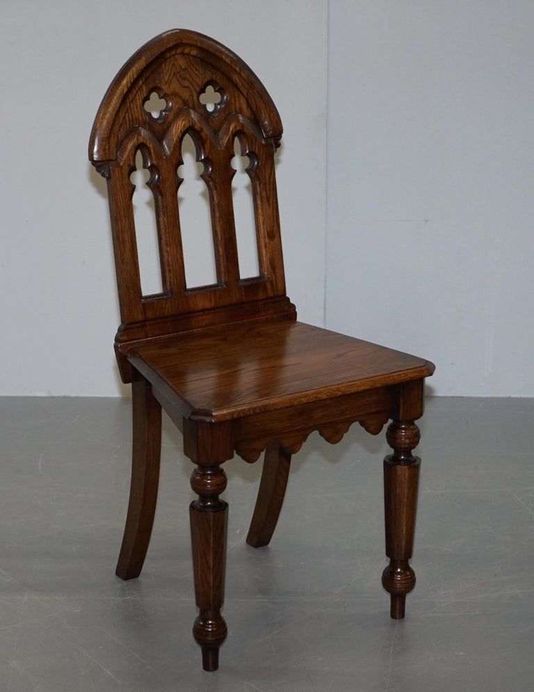 We are delighted to offer for sale this lovely suite of four steeple back gothic oak dining chairs in the Pugin manor  A truly sublime suite of ornately carved dining chairs, they look pure quality from all angles. Clearly base on the gothic