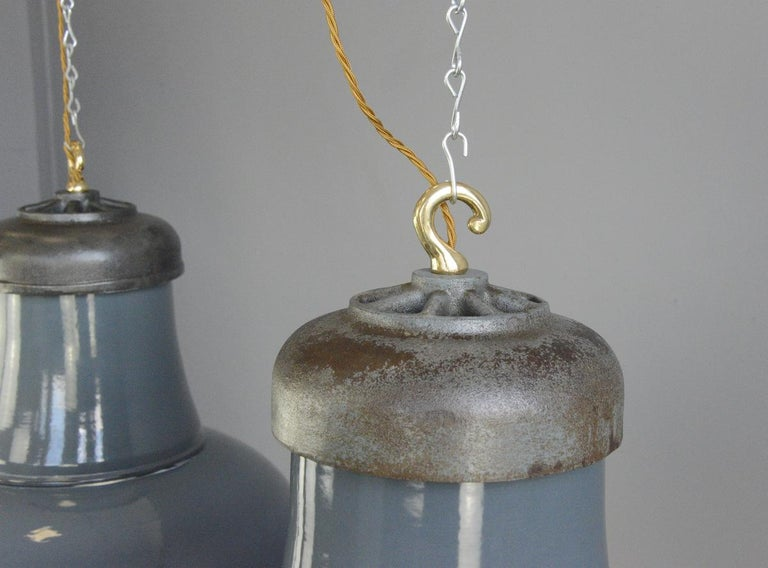 Extra large factory lights by Schaco, circa 1930s  - Price is per light - Dark grey vitreous enamel - White enamel inner reflectors - Cast iron tops with brass hooks - Takes E27 fitting bulbs - Comes with 150cm of cable and chain - Made by