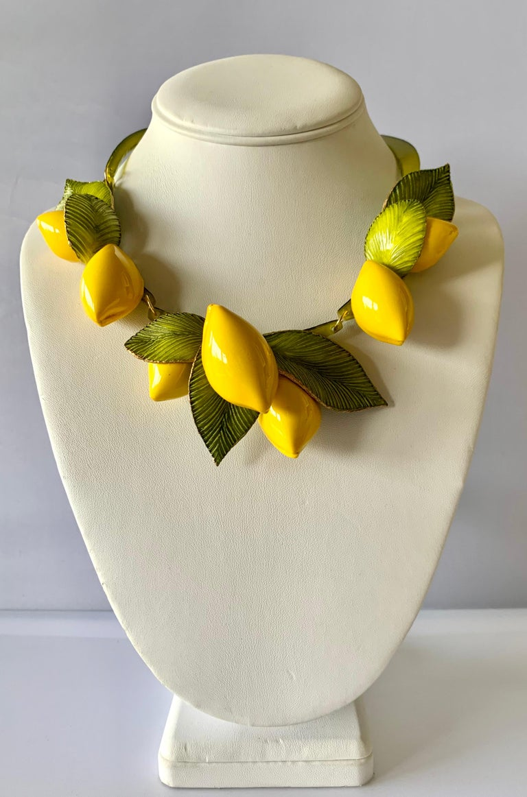 Contemporary fashion-forward giant lemon statement necklace - the bold necklace is comprised out of a row of highly adorned enameline (resin and enamel) yellow lemons. The oversized lemons feature hand-manipulated and etched acrylic details.