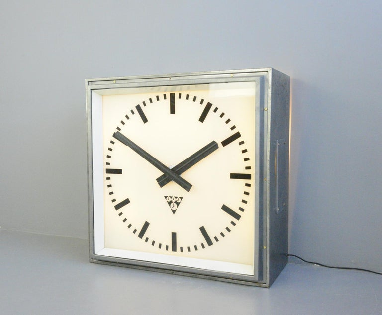 XL light up station clock by Pragotron circa 1950s  - Steel casing - Glass face and dial - Original hands - Can be wall mounted or floor standing - Takes 6x E27 fitting bulbs - The lights are remote controlled - Made by Pragotron - Czech ~