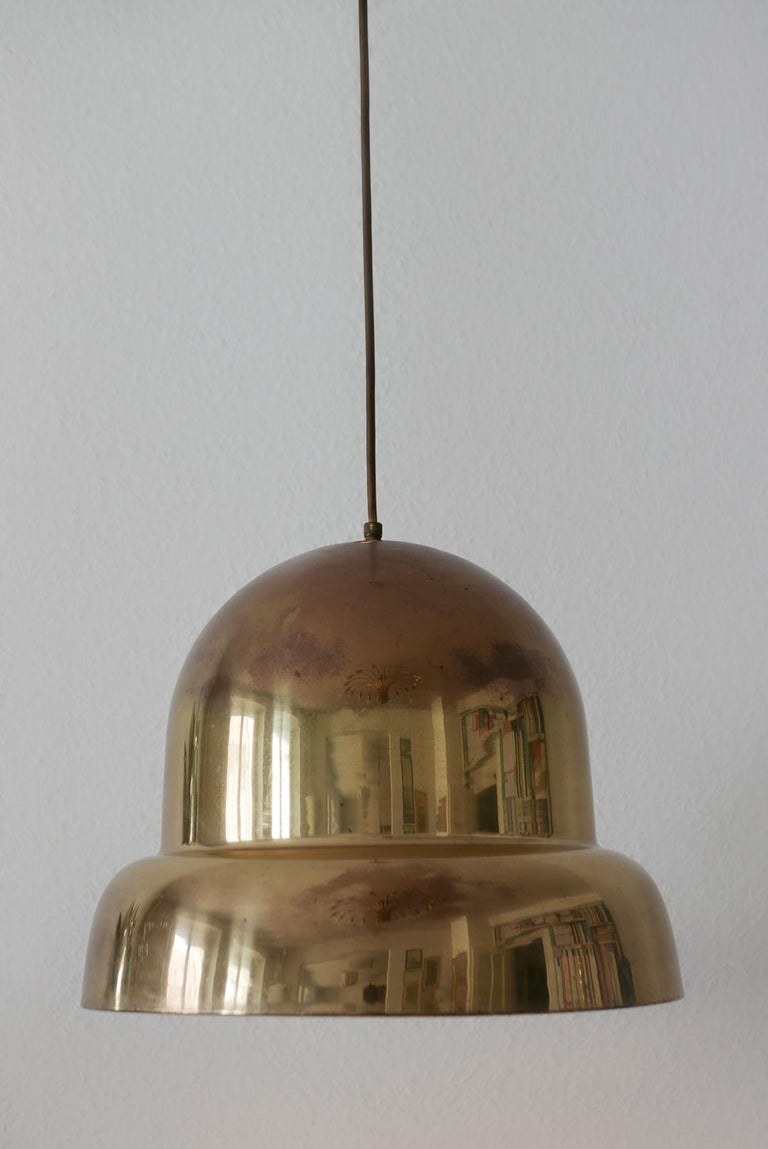 Rare and large Mid-Century Modern pendant lamp or hanging light. Manufactured probably by Bergboms, Sweden, 1950s.  Executed in brass. It needs 1 x E27 Edison screw fit bulb. It runs both on 110 / 230 volt.  Dimensions: H 12.59 in. x Dm 14.96