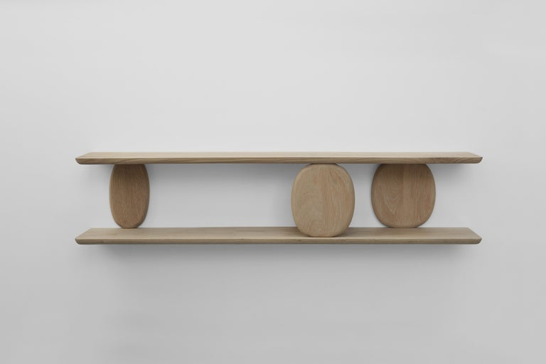 XVIII, Décima Octava is a white oak wall shelf part of Noviembre collection designed by Joel Escalona. This piece invites you to explore form, function and, most of all, the feeling of the slow, opulent and serene lines that characterize each of