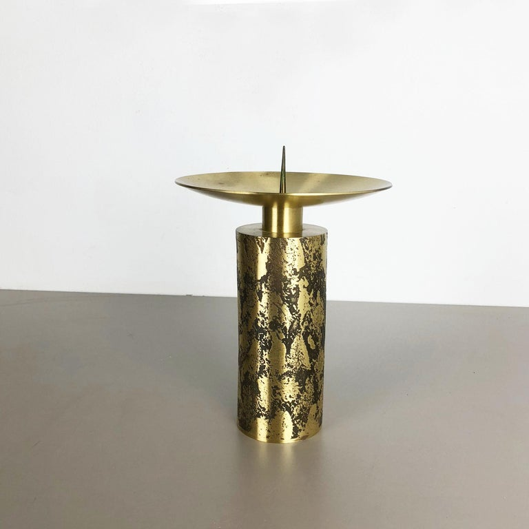 Article:  Brutalist candleholder   Origin:  Germany   Material:  metal   Decade:  1970s   Description:  this original vintage candleholder, was produced in the 1970s in Germany. it is made of solid metal in golden brass tone finish, and has a lovely