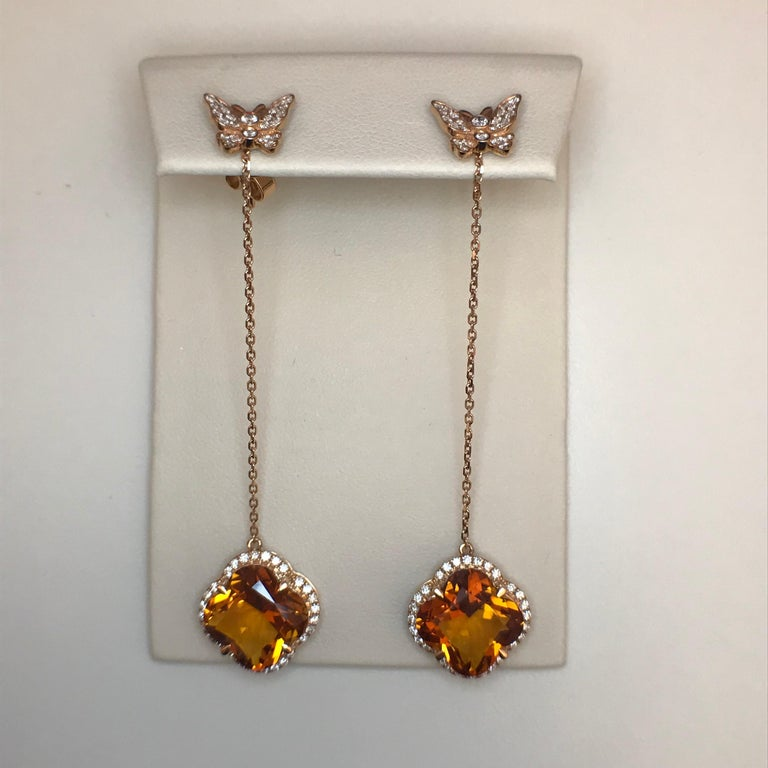 Yael Designs has created a pair of convertible earrings featuring special clover-cut Madeira Citrines dangling from two diamond pave butterflies that can be worn as studs alone!   18kt Rose Gold Citrine 8.74ct White Round Diamonds 0.60ct (G color VS
