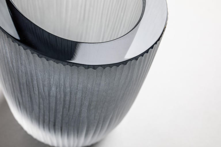 A small yet solid object with a strong presence, the Kasa Container is skilfully crafted by a glass master using a technique involving the layering of cristallo glass to a core of intense color. Once cooled the blown glass body is cut in half, hand