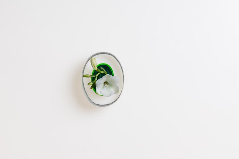 A small yet solid object with a strong presence, the Kasa Mignon is skilfully crafted by a glass master using a technique involving the layering of cristallo glass to a core of intense colour. Once cooled the blown glass body is cut in half, hand