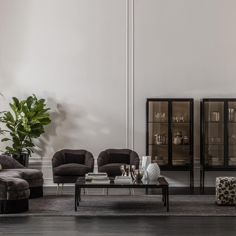 The archetypal elegance of Japanese-style architecture influenced the clean design of this coffee table. Its sturdy walnut structure, finished in glossy dark-brown, comprises a thin rectangular top sitting on slender legs whose linear profile is