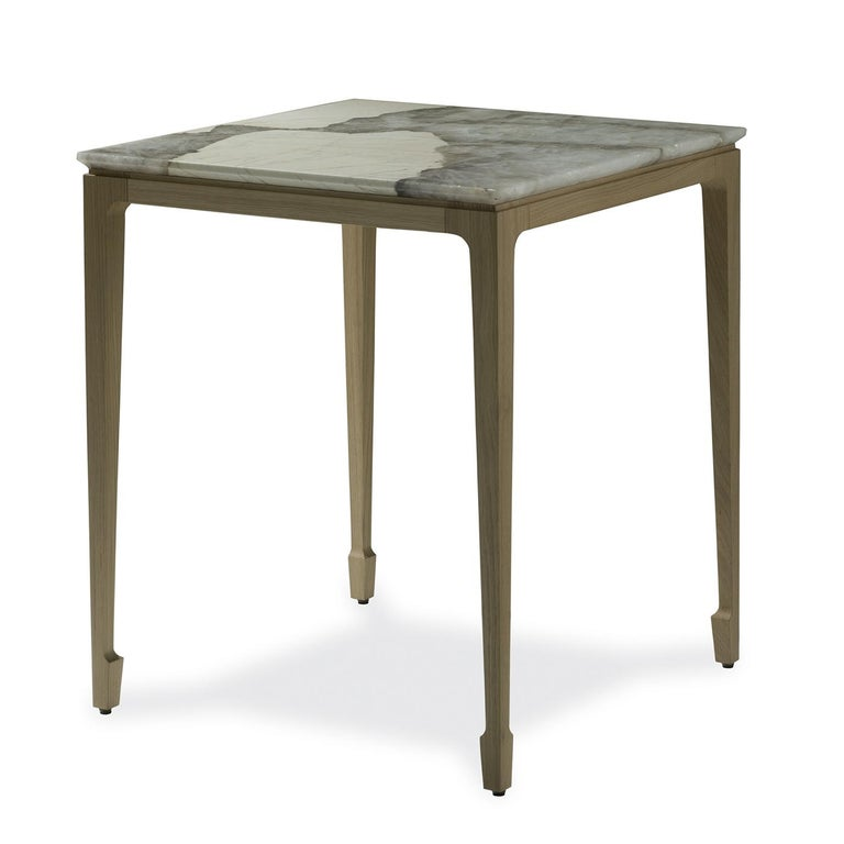 This elegant side table combines two noble and traditional materials with a contemporary design, creating a timeless piece of functional decor that will add charm and refined display surface to a modern or Classic interior. The geometric structure