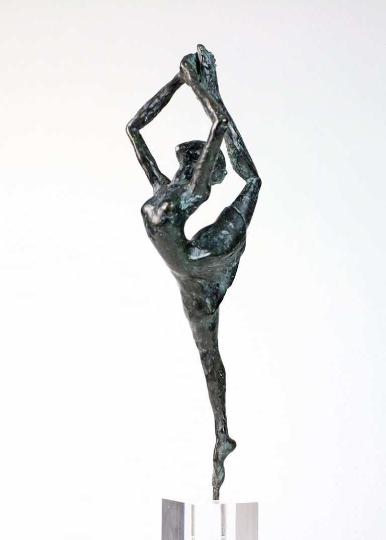 Danseuse Rassemblée is a bronze sculpture by French contemporary artist Yann Guillon. Dimensions of the bronze sculpture: 25 x 10 x 5 cm. Height with the plexiglas base: 35 cm Yann Guillon focuses his work on the human body, using an expressionist