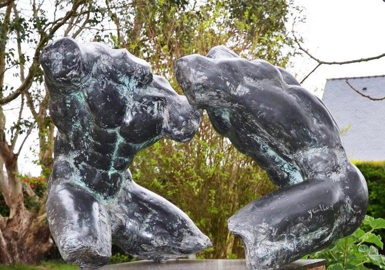 Wrestlers IV, is a large-scale bronze sculpture by French contemporary artist Yann Guillon. It depicts two men engaged in a wrestling bout. 100 cm × 200 cm × 90 cm. Yann Guillon focuses his work on the human body, using an expressionist approach to