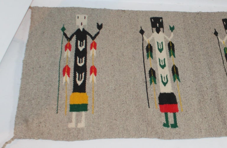 This Yea Indian weaving is in cool neutral colors and in good condition. It has the original corner ties.