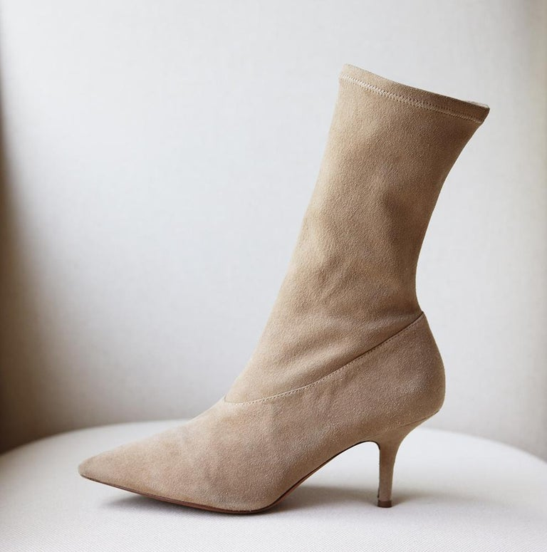 Yeezy Season 5 stretch-suede ankle boots are made from soft beige suede and have distinctive 70 mm heels. They're a great year-round option and fit closely around the ankle and calves thanks to the discreet zips and elasticated fit. Heel measures