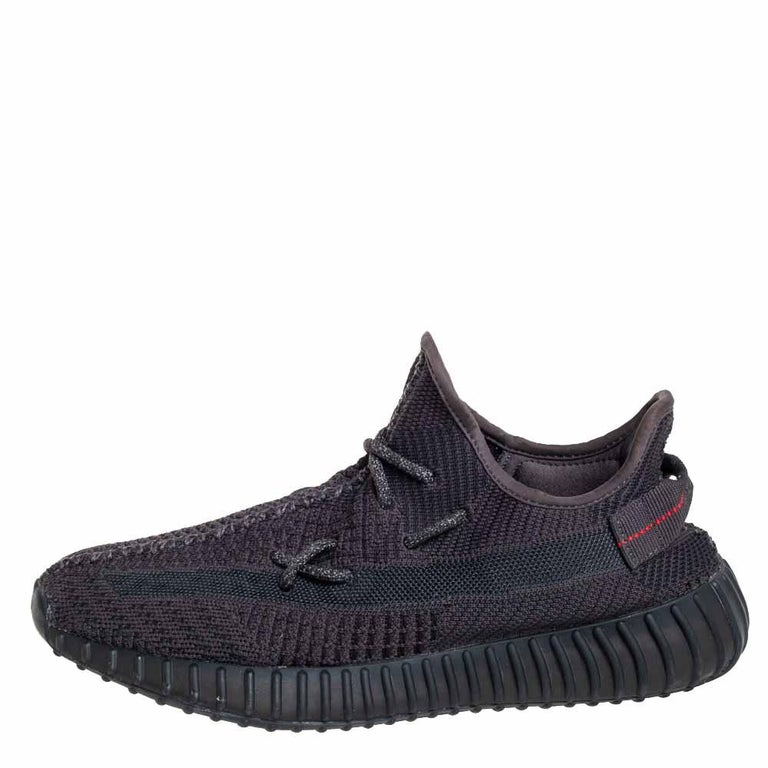 Catch on with the trend of designs from the Yeezy x Adidas collaboration with this pair of Boost 350 V2 sneakers. The knit fabric pair features great cushioning, lace-ups on the vamps, and tubular rubber soles. This pair comes in black with pull